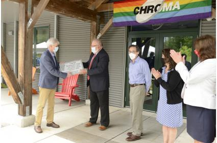 CEO Newell Lessell is awarded the Deane C. Davis Award at a small ceremony at Chroma Technology's headquarters in Bellows Falls, Vermont