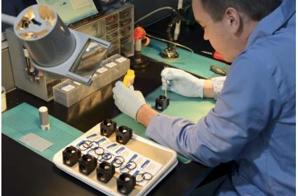 Derek Trudelle assembles filter sets into microscope filter cubes at Chroma in Bellows Falls, a manufacturer of optical filters.